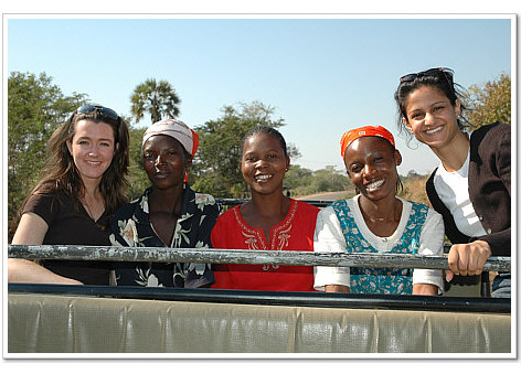 Two participants and Zambian ladies enjoy a drive in Mfuwe.